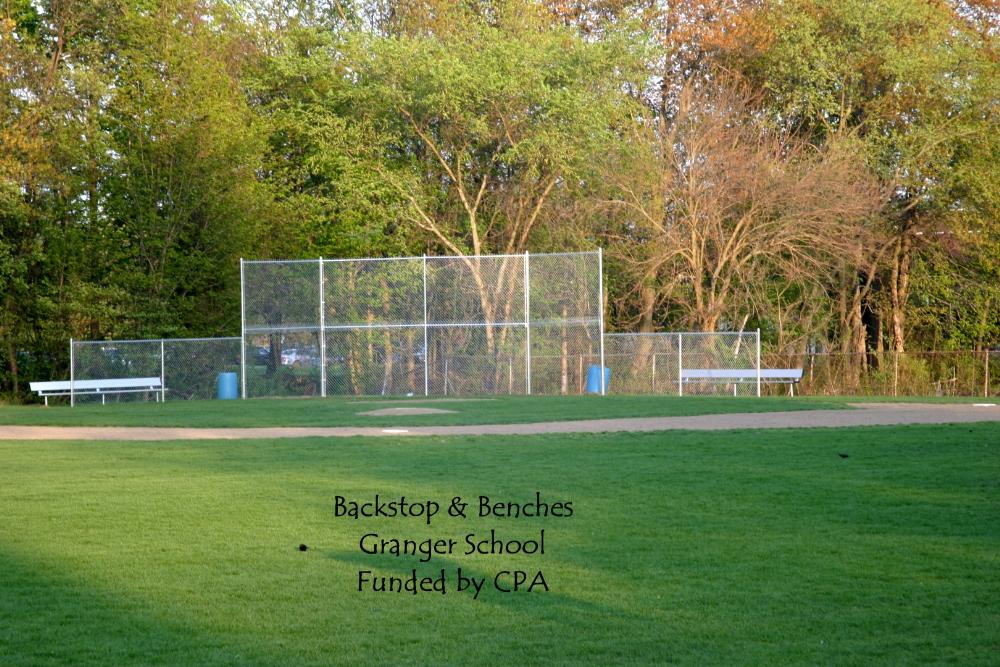 Backstop and benches at the Granger School