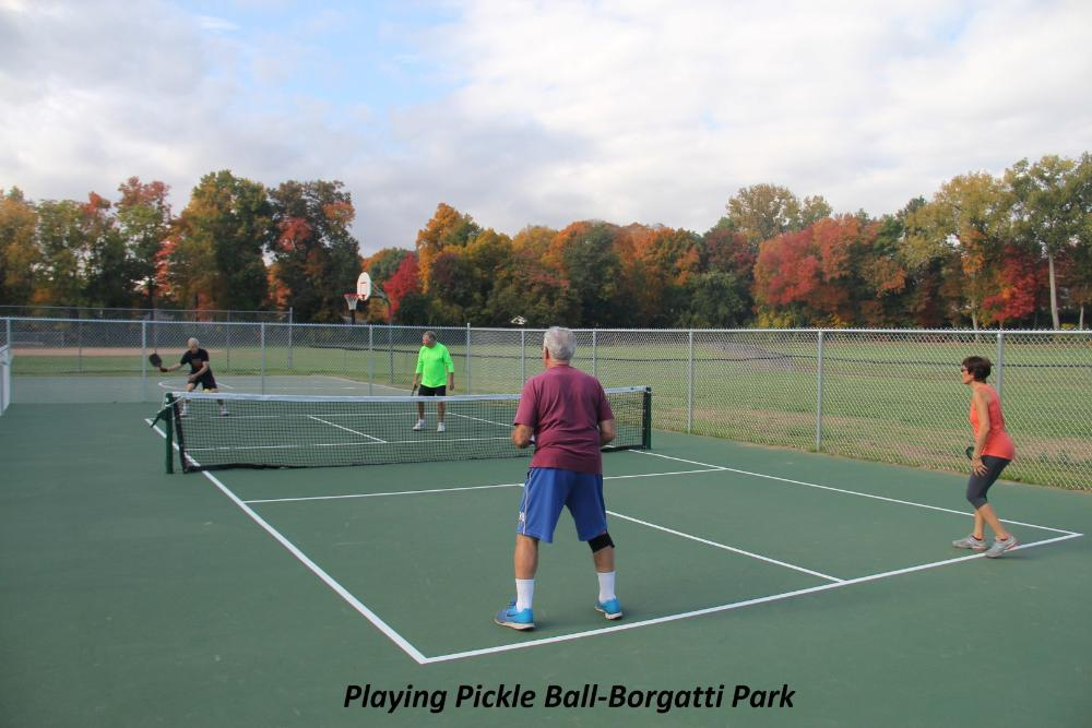 Playing Pickle Ball - Borgatti Park