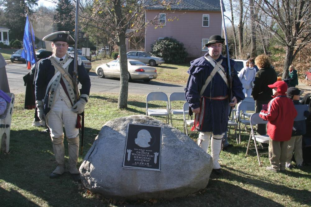 Reenactors standing by the George Washington Memorial Plaque