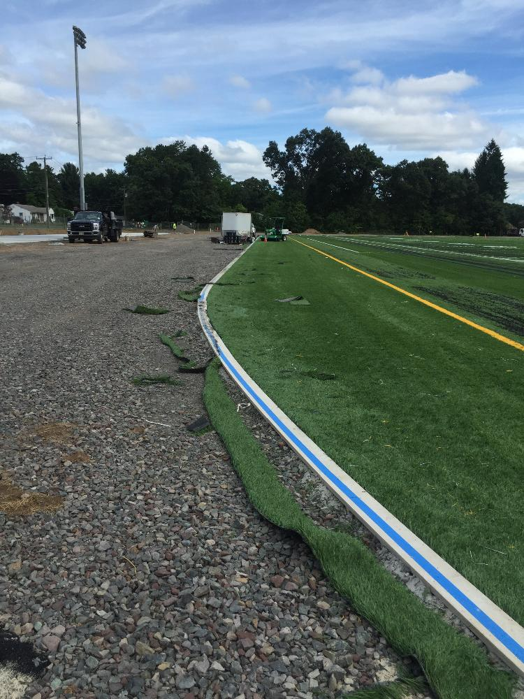 Artificial turf being finished